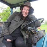 Rosie, heavily pregnant, seated at the wheel of a tractor