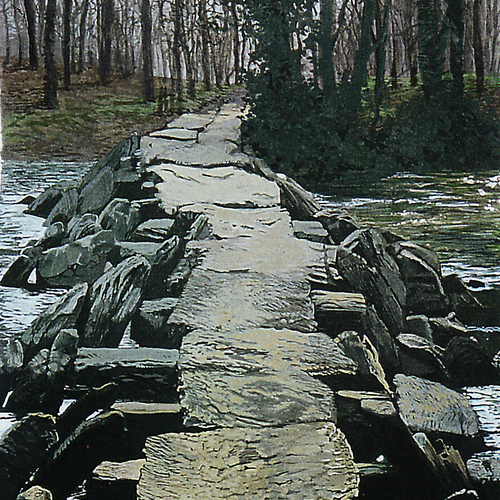 Stone bridge with path running off into woodland